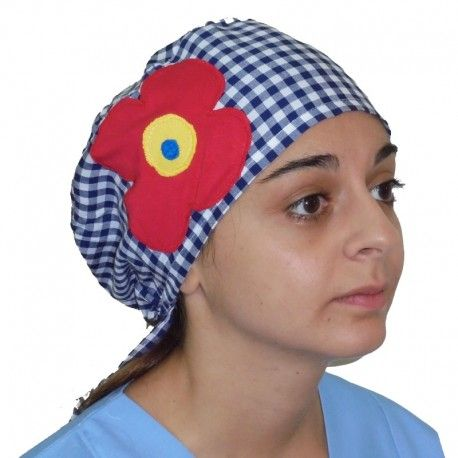 Handmade applique scrub. Checkered design with a big red daisy on one side.