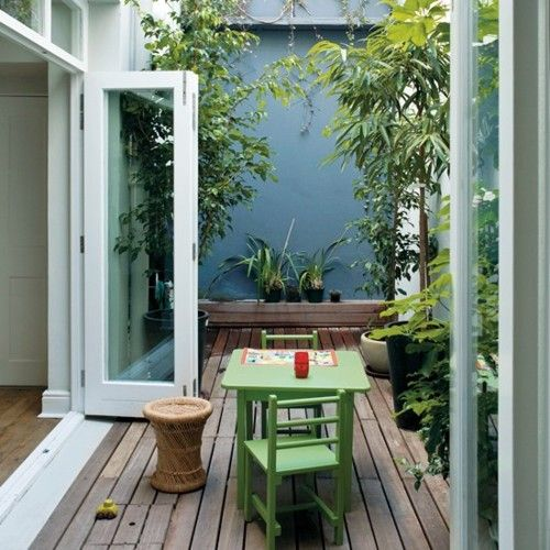 green-home:    I think painting a tiny courtyard garden wall, in a strong colour is a great way to create cohesion outdoors. It also makes a striking backdrop for lush green shade planting. I'm looking at Dulux for mixed-to-order coloured masonry paints.  Photograph by Russell Smith    I painted my backyard fence in same color and my plants look a lot more happy and vibrant against it