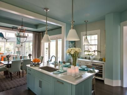coastal-inspired kitchen flanked by dining and living areas