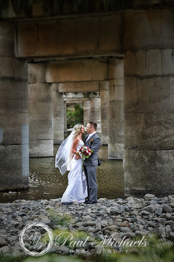 Bride and groom at the hutt river close to Silverstream retreat. PaulMichaels wedding photography Wellington http://www.paulmichaels.co.nz/
