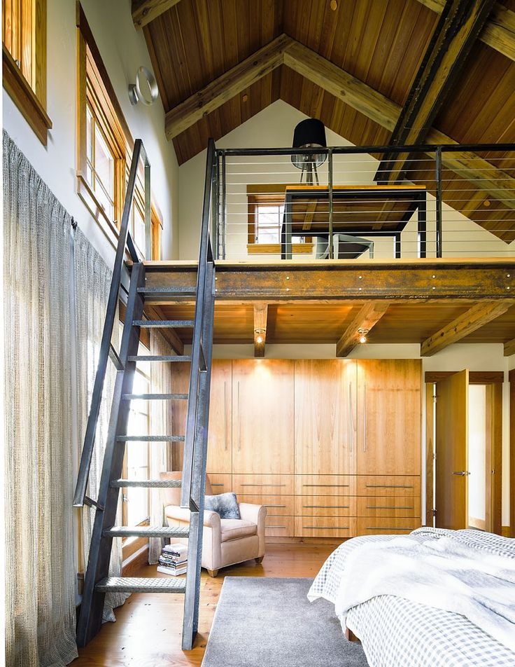 High ceilings in the master bedroom reveal a loft space that functions as a  secluded home