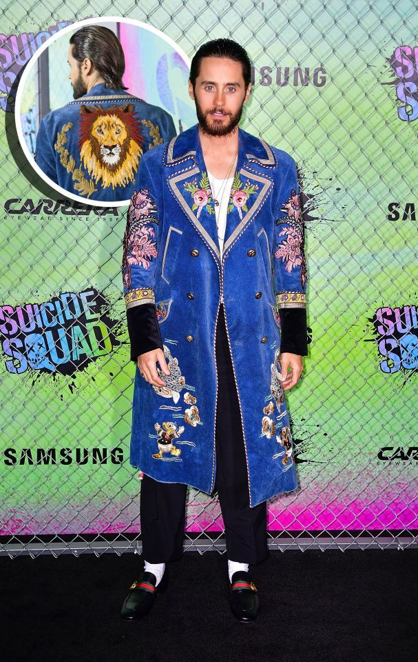 Jared Leto, who plays The Joker in <i>Suicide Squad</i>and took his method acting very seriously throughout filming, played the part of Gucci ambassador very well at the premiere wearing an ensemble straight off the runway. The singer paired a blue suede coat with flower, Donald Duck, and lion patches on it with loafers and cropped trousers. <i>(Photo: Getty Images)</i>