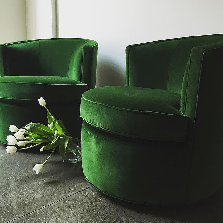 Twin Otis swivel chairs in velvet emerald.
