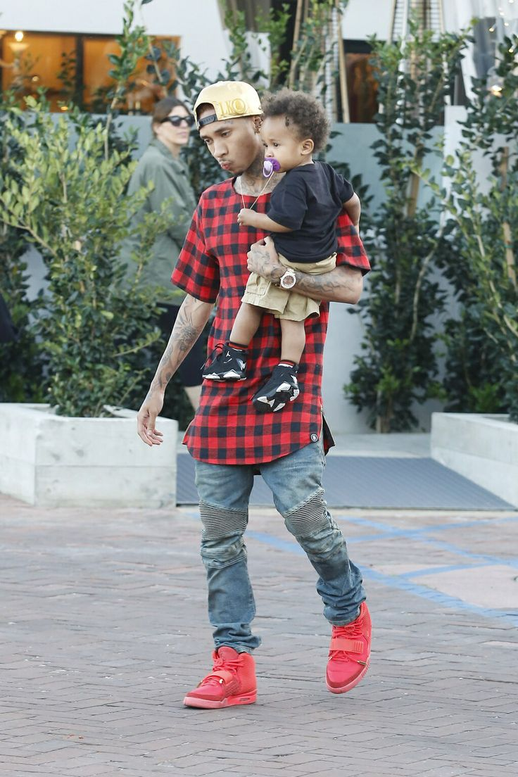 Tyga and his baby boy king Cairo but i just call him KC for short he is the cutest baby ever. i just love his cubby cheeks. lol