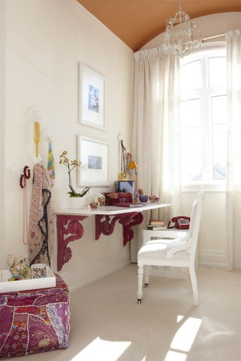 Desk/vanity made of shelf brackets and wood.