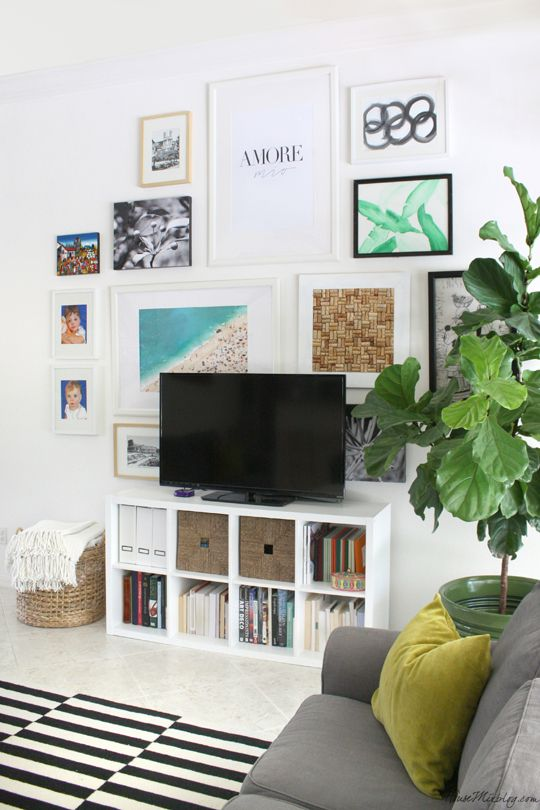 Ikea living room with gallery picture wall behind tv