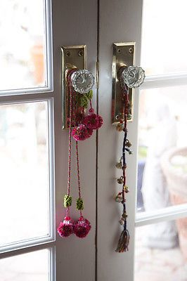 Add bells, tassels & charms Placing bells, tassels and charmsonto your doorknobs and drawer nobs adds just a little touch of whimsy and... you guessed it... charm ;)
