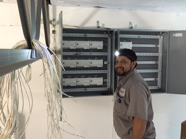 Roque A Hvac Technician Is Working Hard On A Commercial Job Site