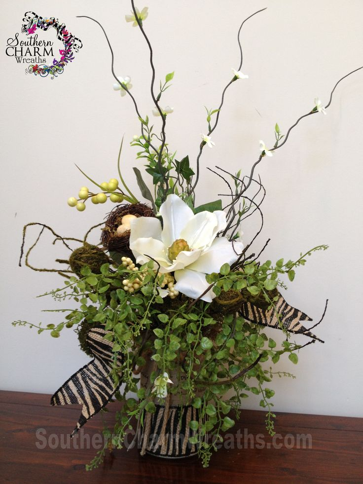 Silk flower arrangement with burlap covered jar and