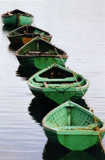 Green canoes--I just love photos of boats!
