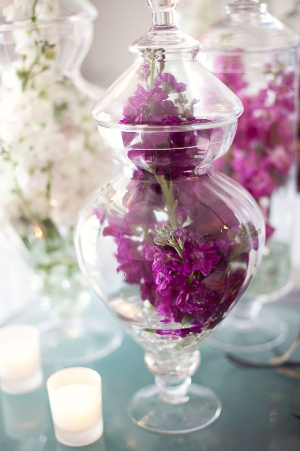 Doesn't have to be purple but big flowers in jars would be pretty, with candles around them?