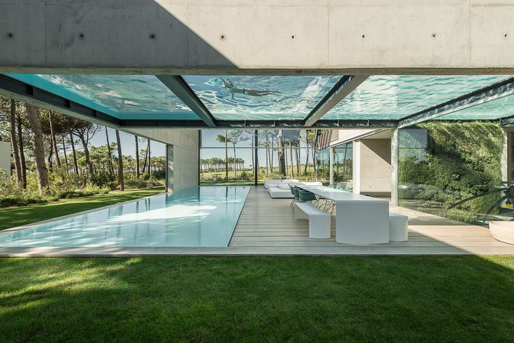 The Wall House in Cascais, a coastal town in an area known as the Portuguese Riviera, is an 11,840-square-foot home made with concrete, wood, and glass—and boasts a pair of large swimming pools on two levels.