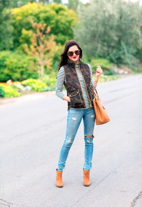 Casually stylish: Camo vest, ripped jeans, tan bag and booties.: