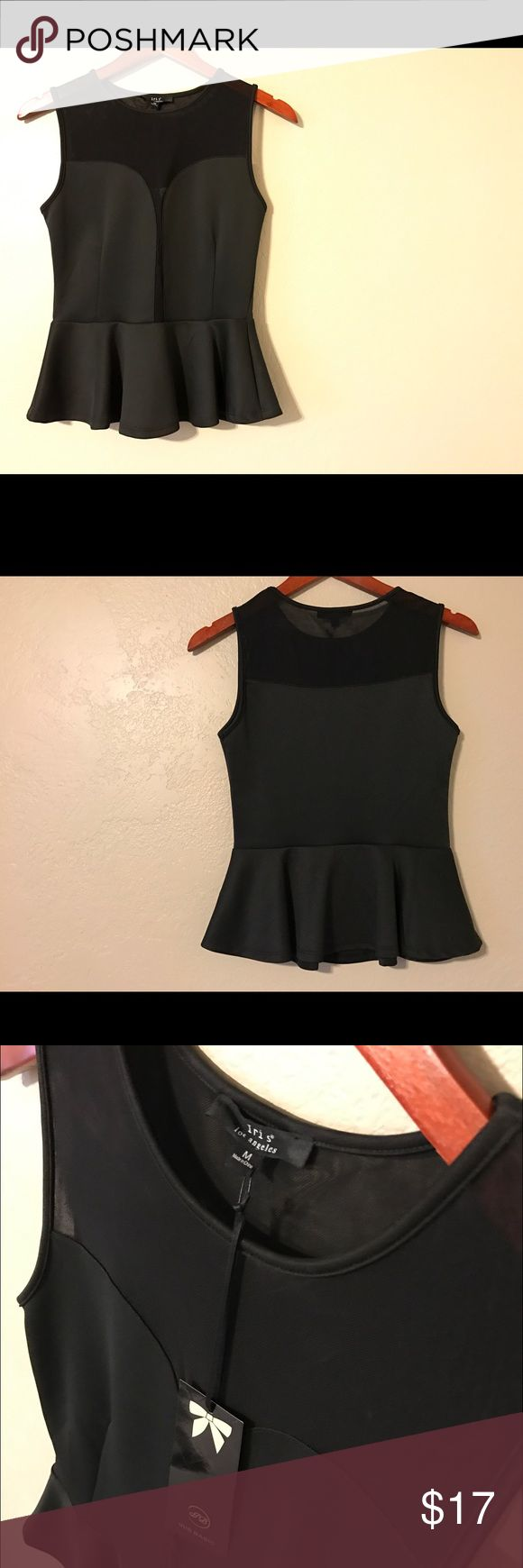 NWT Iris Basic Black Peplum Top - Sz: M NWT Iris Basic Black Peplum Top - Sz: M - sheer, tight mesh fabric above chest and down through the middle to the horizontal seam - classy night look - can be worn with, leggings, skirts or jeans - awesome wardrobe piece! Iris Basic Tops