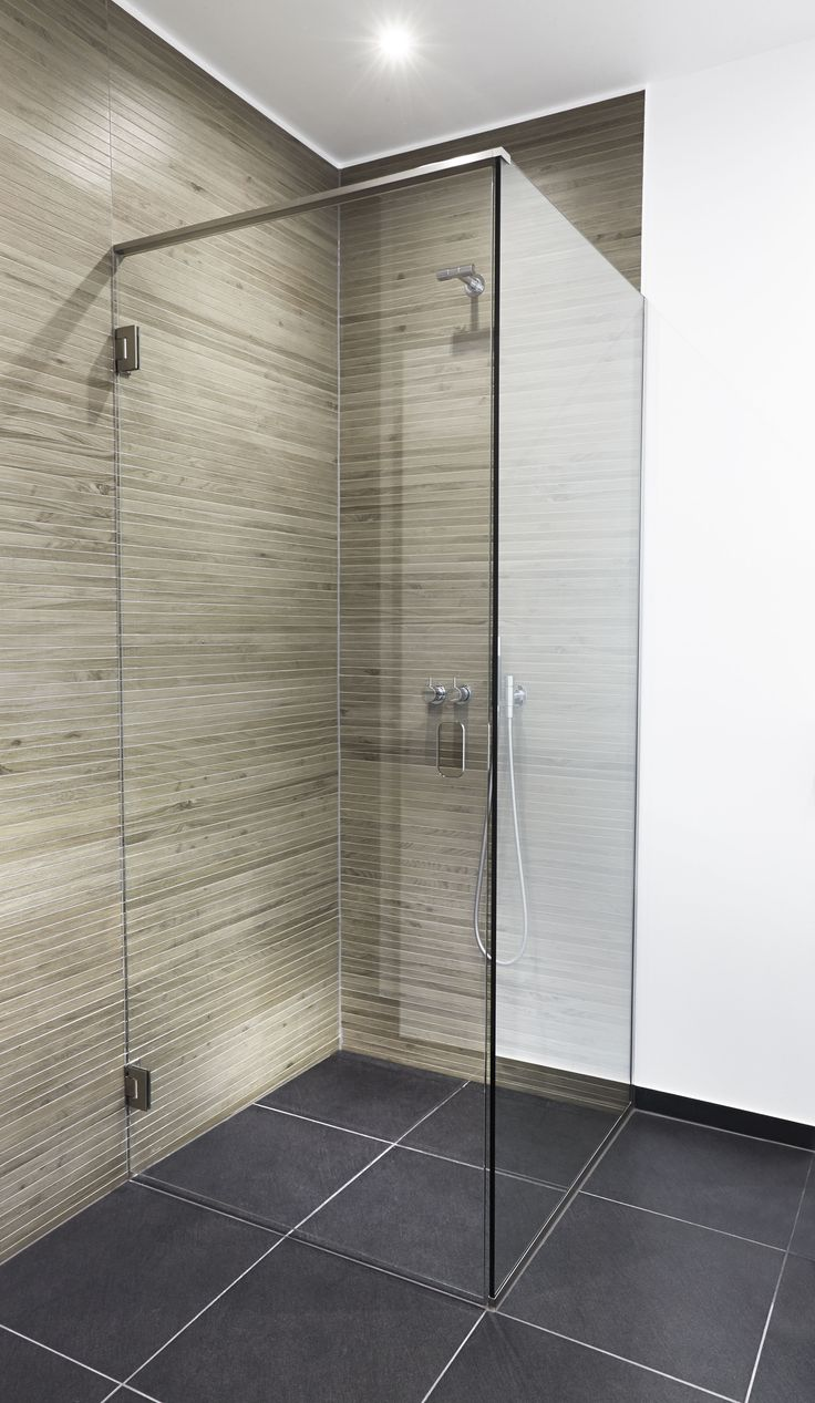 Unidrain GlassLine shower door, GlassLine shower screen and Unidrain HighLine Custom floor drain which creates a smooth and minimalistic look