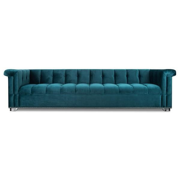 This is the kind of sofa you can have in a lounge or a study and it just sets the mood. Completely tufted in rich, smooth Mystere Peacock velvet, this sofa has all the style and cool that one can ask