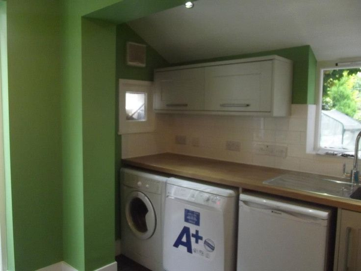 An awkward sloping ceiling was a problem so we used shallow depth wall cabinets to overcome this.  http://www.ppmsltd.co.uk