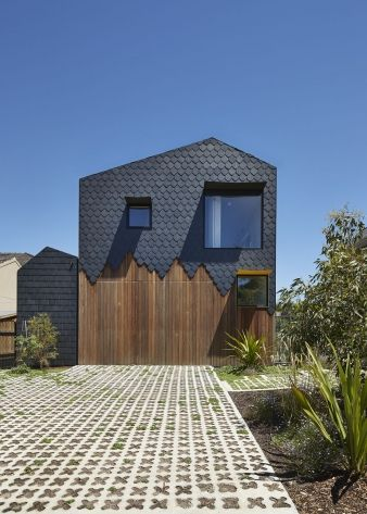 The cladding appears to drip down over the exterior of the home