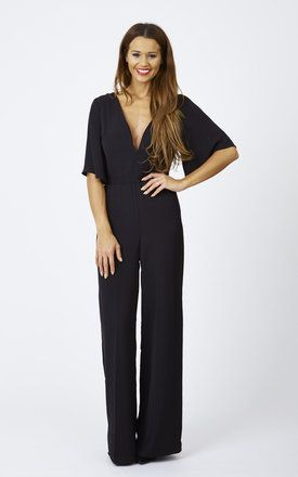 The wide leg and plunging back on this jumpsuit make it a beautifully sophisticated staple for your wardrobe. Perfect for a nice dinner or night on the town.