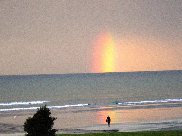 LocumLENS Finalist #7  Talk about serendipitous; capturing a rainbow on Ohope Beach in the Bay of Plenty, New Zealand. Photo courtesy of Dr. Karl Morgan.