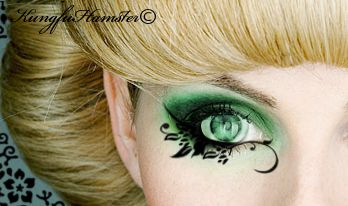 Green to black with nature like markings along eye