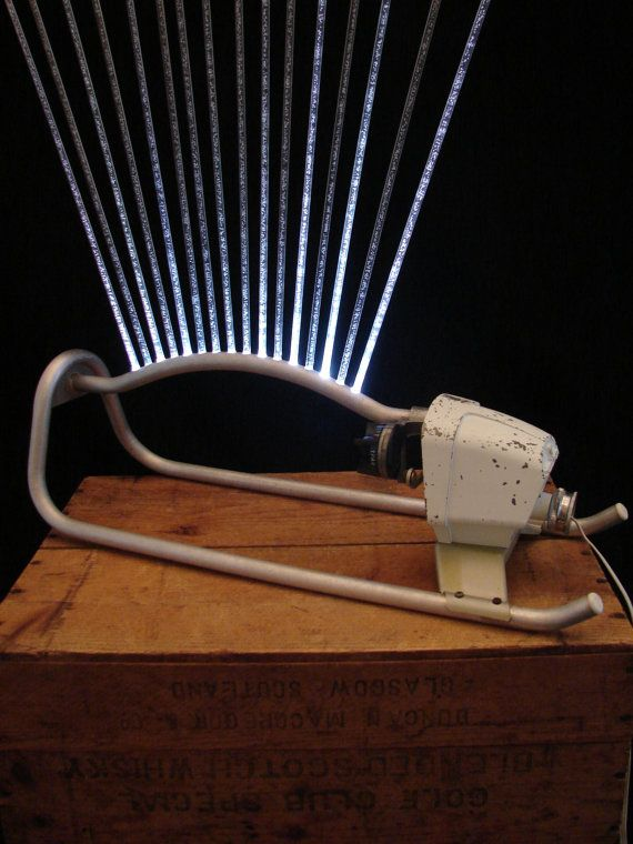 This is the best upcycled piece I've ever seen!  Upcycled Vintage Garden Sprinkler LED Lamp by BenclifDesigns, $320.00
