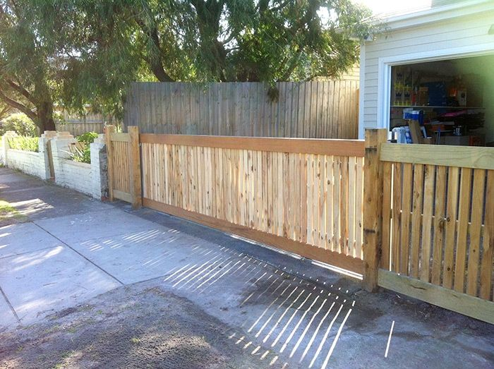 Horizontal picket front feature fence with exposed posts and capping with sliding gate. Styles of fences