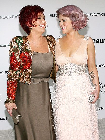 Sharon Osbourne and Kelly Osbourne... Love Kelly's hair! It's pink in a classy was