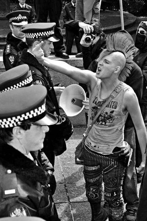 Punk, Anarchy, Protest, Bullet belt, Tight jeans, Patches.
