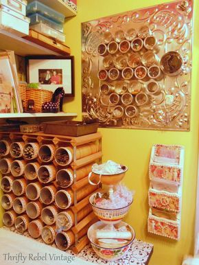 Pringle cans, covered with paper, stored in wine racks, make wonderful storage #Thrifty