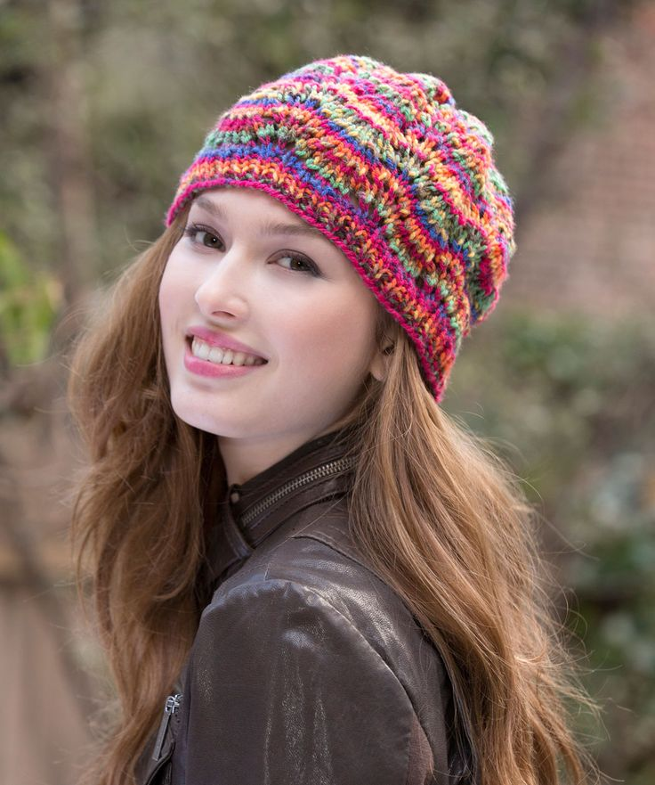 Just one ball of yarn makes this colourful hat! The knit ripple pattern creat...