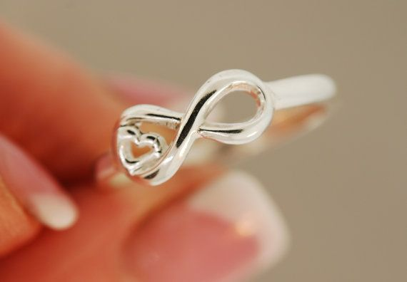 Heart and infinity ring @Kailey Spence Spence Alyssa saw this and thought of you cuz its kinda like your tatoo you want.