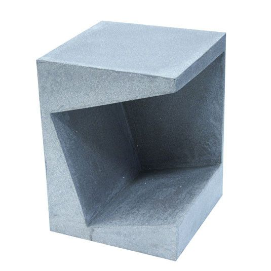 http://www.hollys-house.com/collections/new-in/products/concrete-side-table-with-magazine-shelf