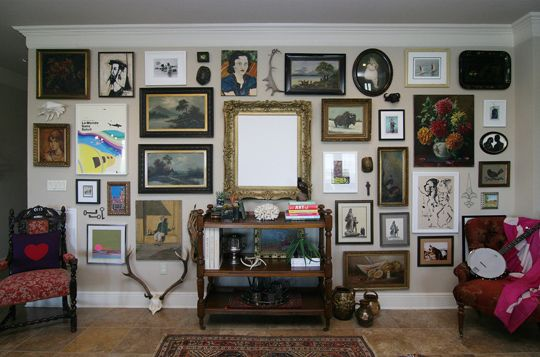 I want to do a wall with all mismatched frames & pictures.  It's a great lived-in feeling....I love homes where there's a story.