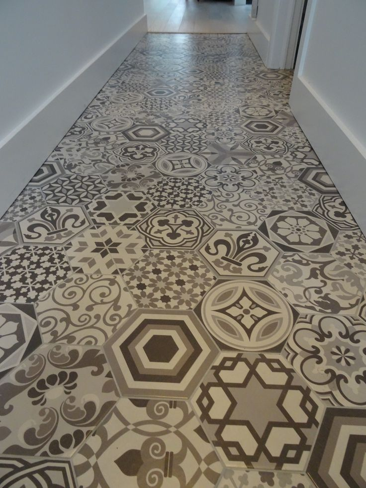 Mix and match flooring adds the perfect amount of classy character to a front entrance floor. Check us out on bmcinteriors.com for more funky and unique renovation ideas!
