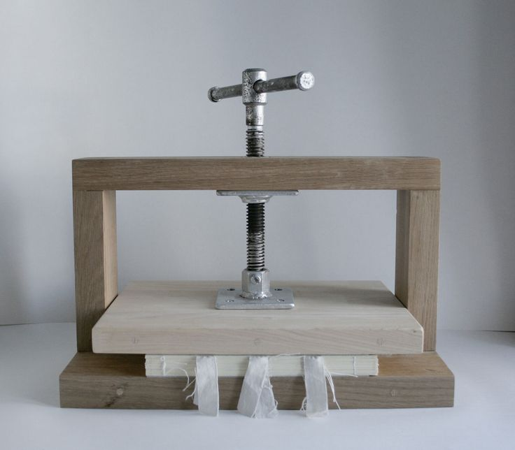 Simple wood book press - I need to remove warping on many books I want to sell so I will try this and look for other book presses I can make.