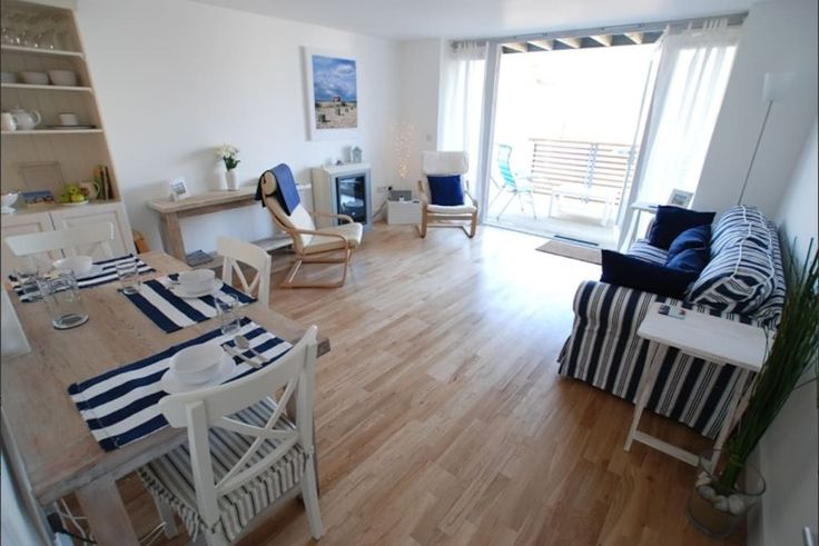 """House in Camber, United Kingdom. Seconds from the beach! Tucked right behind the sand dunes. Modern, stylish eco-holiday home with white walls + oak floors, beside 7 miles of sand on the best beach in South East England. Our spacious living room - with 50"""" Smart TV + complimentar..."""