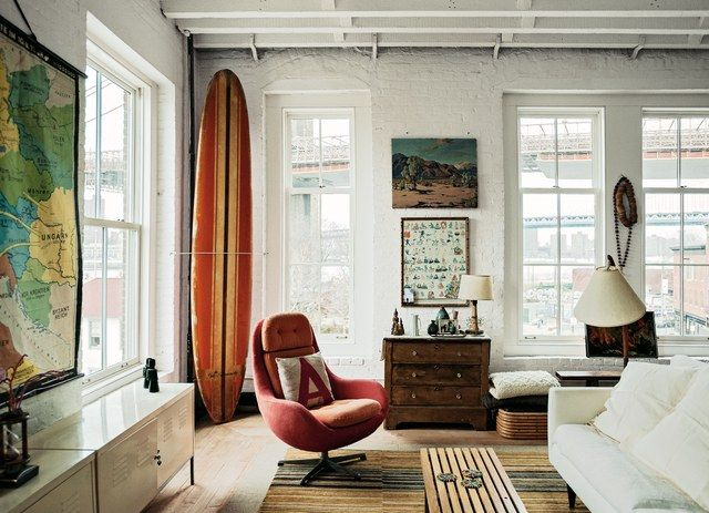 This art-filled loft is the resting place for a surfboard that's been in the owner's family for decades.