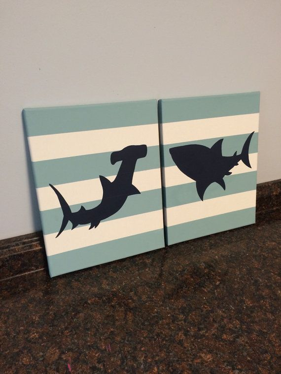 These adorable shark paintings would look great in a nursery, room, bathroom, beach house, etc. Hand painted on back stapled canvas. The