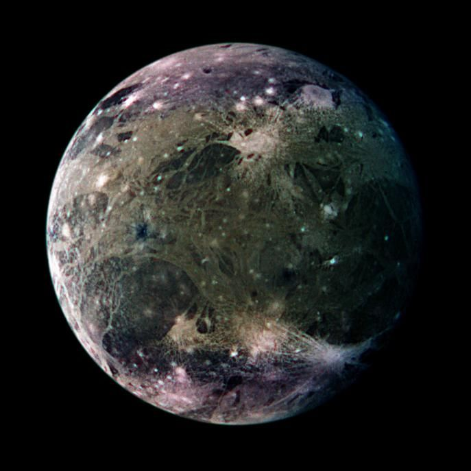 Ganymede Enhanced:  What does the largest moon in the Solar System look like? Ganymede, larger than even Mercury and Pluto, has a surface speckled with bright young craters overlying a mixture of older, darker, more cratered terrain laced with grooves and ridges. Like Earth's Moon, Ganymede keeps the same face towards its central planet, in this case Jupiter.