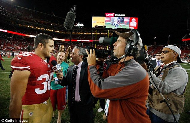 The 'Hayne Plane' is swarmed by reporters on the field after his NFL preseason game against the San Diego Chargers