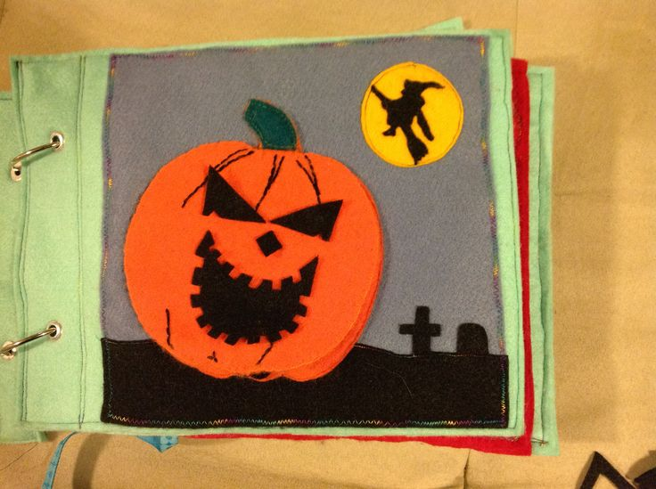 Quietbook page - jack o'lantern. Original pattern. The pumpkin flips up and reveals a pocket for additional faces.