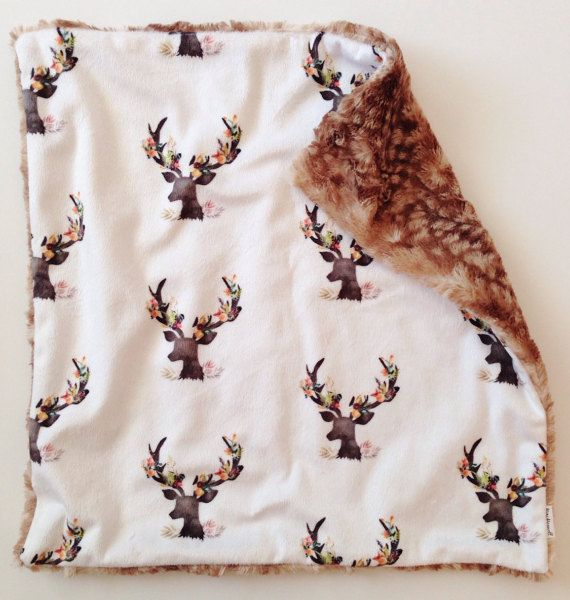 These are the softest lovey blankets! We imagine this is what it feels like to snuggle a big fluffy cloud! Gorgeous deer antlers adorned in a variety of beautiful blooms on a minky print for the front, backed with snuggly fawn minky. Thats right! Both sides are amazingly soft which means double the cozy cuddle!! Measures approximately 17 x 17 inches. Just the right size for those sweet little hands to snuggle. Perfect size for on the go! Fits right into the diaper bag & perfect for baby to…