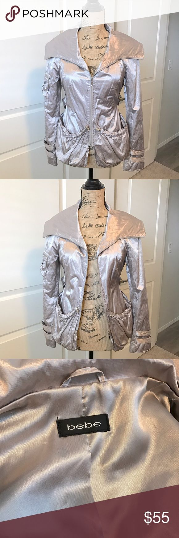 BEBE women's metallic silver zip up jacket Super chic women's metallic silver zip up jacket. Gently used. In excellent condition. Lots of compliments when I wore this beauty :) bebe Jackets & Coats