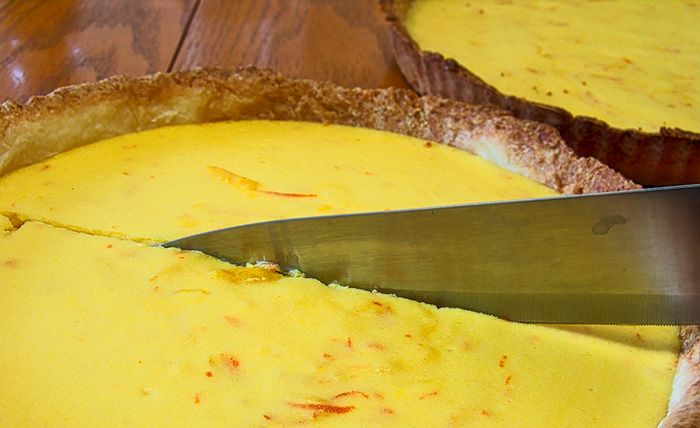 Yuzu juice comes from a Japanese citrus varietal and has the flavour of a cross between lemon and tangerine. Yuzu juice makes a perfect base for this twist on a classic French lemon tart. You can also make the curd, chill it and spoon it over fresh berries or sliced peaches for a light dessert.