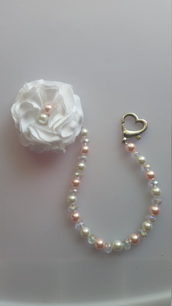 Check out this item in my Etsy shop https://www.etsy.com/listing/243285071/pearl-beaded-pacifier-clip