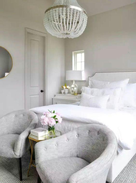 Serene white bedroom with a flowery touch     www.bocadolobo.com #bedroomdecorideas #bedroomdecor #masterbedroom #masterbedroomideas #minimalistbedroom #luxurybedroom #dreambedroom