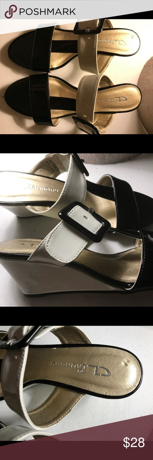 Chinese Laundry black and white wedges size 6 This is a pair of beautiful black and white Chinese Laundry wedges with buckle in almost new condition. There is but a few marks on the shoes very minor. Chinese Laundry Shoes Wedges