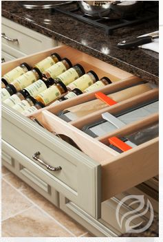 Spice drawer with dividers with aluminum foil and plastic wrap cutter/ dispenser
