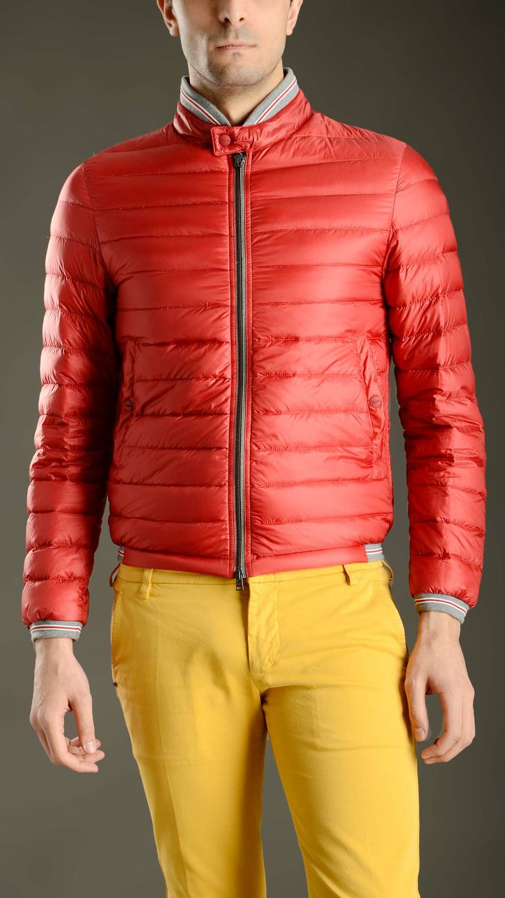 Water repellent and windproof red padded quilted bomber jacket featuring a ribbed Mandarin and a grey and white striped hem, cuffs and collar, a front zip fastening, buttoned side welt pockets, long sleeves, a straight hem, 95% goose down, 5% down.